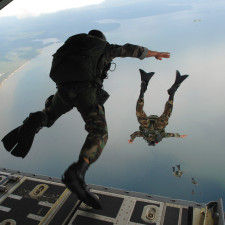 U.S. Air Force Airmen from the 720th Special Tactics Group out of Hurlburt Field, Fla., jump out of a C-130J Hercules aircraft during water rescue training over the Destin coastline in Florida Oct. 3, 2007. The training is designed to enhance aerial zodiac deployment and personnel recovery. The aircraft belongs to the 41st Airlift Squadron out of Little Rock Air Force Base in Arkansas. DoD photo by Senior Airman Julianne Showalter, U.S. Air Force. (Sovereign Person)