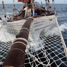 Naga Pelangi beating into a 25 knot wind for an Offshore Investment Account