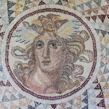 Floor mosaic, detail of the gorgone Medusa, opus tessellatum, found in Zea (Piraeus). 2nd century CE - Economist